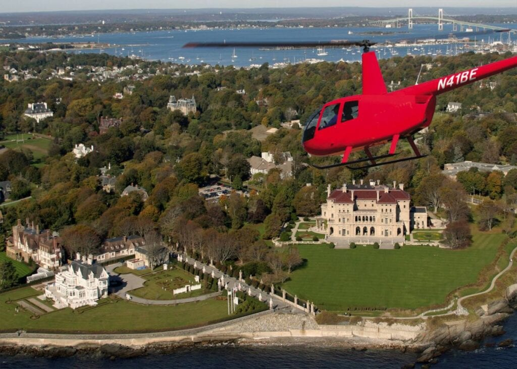 red helicopter flying over newport